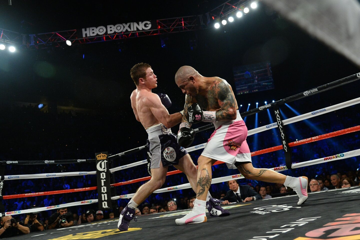 Canelo Alvarez (purple trunks) and Miguel Cotto (pink trunks) box during their WBC & Ring Magazine middleweight boxing title fight at Mandalay Bay Events Center. Alvarez won via unanimous decision.