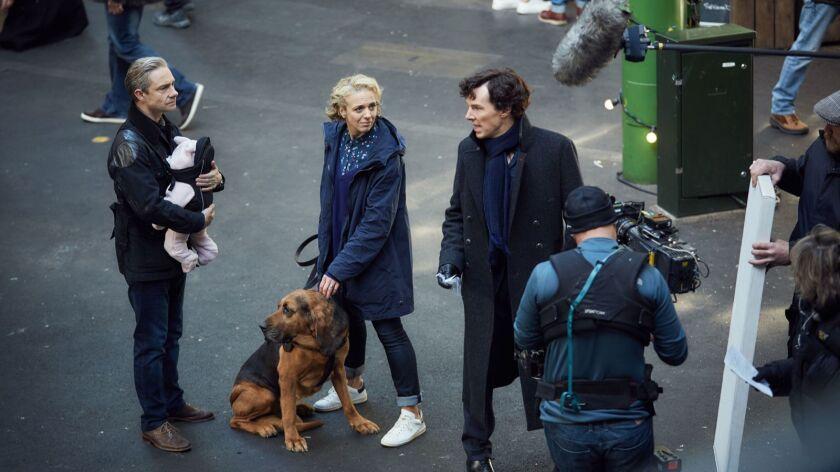 "Martin Freeman, Amanda Abbington and Benedict Cumberbatch film a scene for ""The Six Thatchers,"" the opening episode in the fourth season of ""Sherlock."""