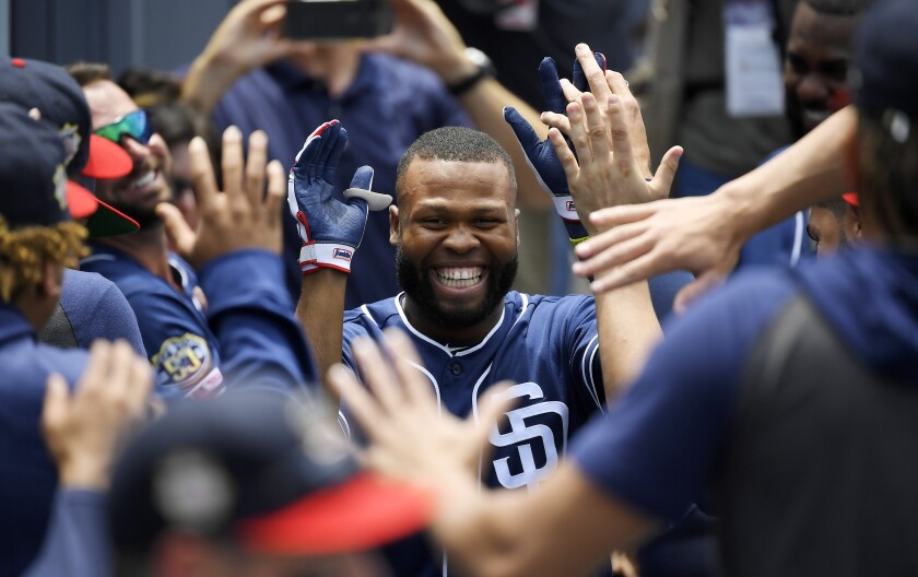 Manuel Margot is congratulated by his Padres teammates after hitting a home run against the Dodgers on July 7.
