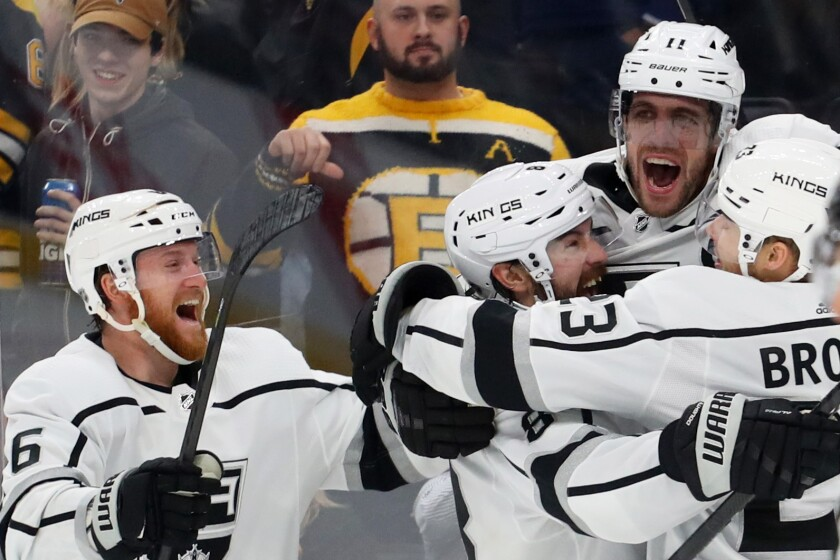 Kings captain Anze Kopitar, top right, celebrates with teammates (from left) Joakim Ryan, Drew Doughty and Dustin Brown.