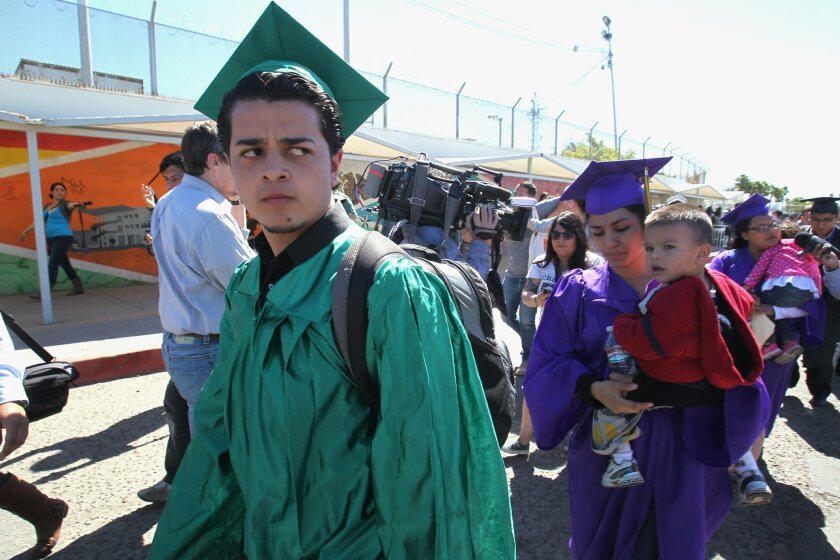 Dreamers dressed in their High School graduation gowns marched towards the Otay Mesa Port of Entry.