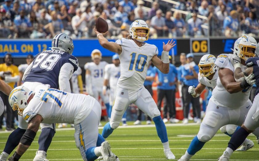 Chargers quarterback Justin Herbert passes during a loss to the Dallas Cowboys on Sept. 19, 2021.