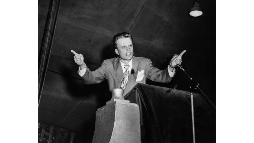 Oct. 30, 1949: Dr. Billy Graham, evangelist, delivers sermon to crowd attending revival meeting in large tent at Washington Blvd. and Hill St.