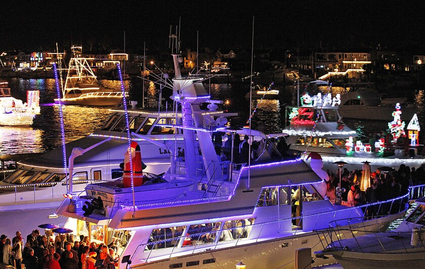 Where are the customers' yachts? Luxury craft decorated for Christmas jam Newport Harbor in this 2012 photo.