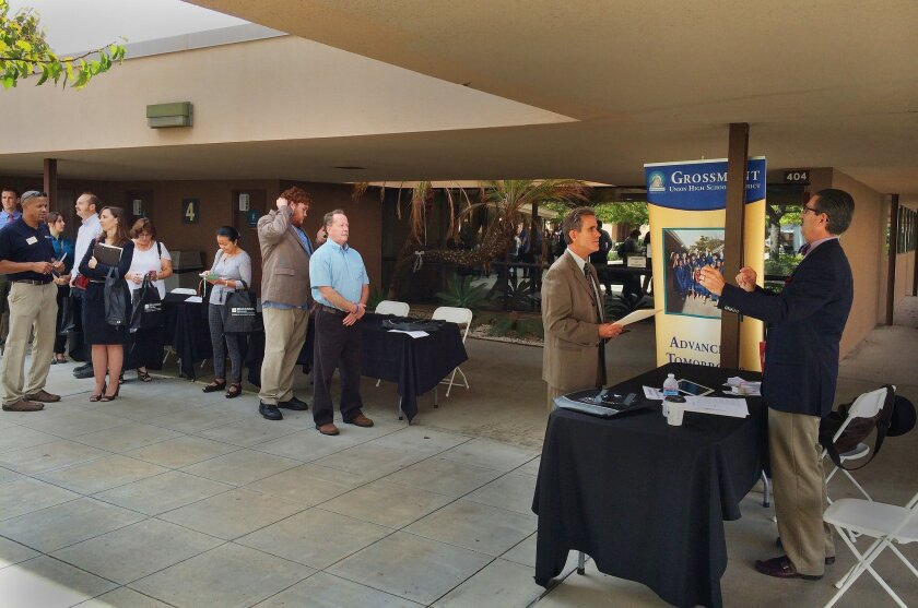 The longest line at Saturday's teachers job fair was for the Grossmont Union High School District. At right is Steven Sonnich, Grossmont's associate administrator for human resources.