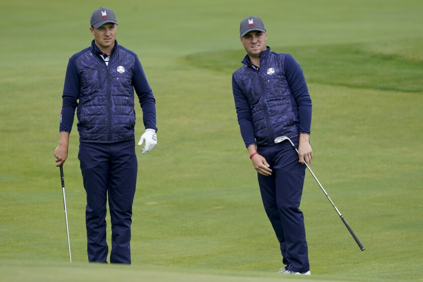 Team USA's Jordan Spieth watches a shot by Team USA's Justin Thomas during a practice day at the Ryder Cup at the Whistling Straits Golf Course Tuesday, Sept. 21, 2021, in Sheboygan, Wis. (AP Photo/Charlie Neibergall)