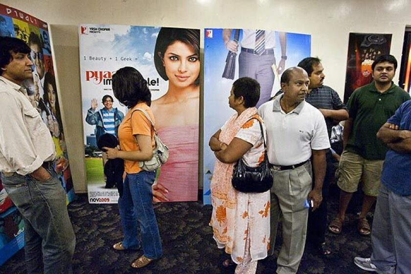 Moviegoers line up in the lobby of San Jose's Towne Theatre, which features Indian movies exclusively. Operator Big Cinemas aims to build the nation's first theater circuit catering to Indian Americans and other ethnic groups passed over by the major chains.