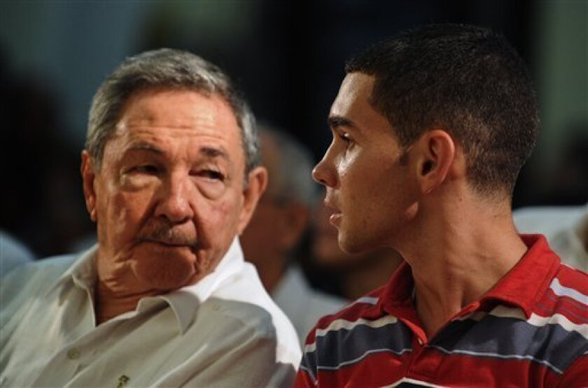 Cuba's President Raul Castro, left, and Elian Gonzalez attend an official event in Havana, Wednesday, June 30, 2010. Castro and a now 16-year-old Gonzalez attended an official event marking the 10-year anniversary of the time when the former cast away child whose mother died at sea became the center of a politically-charged international custody battle, ending with his reptriation to Cuba and his father. (AP Photo/Adalberto Roque, Pool)