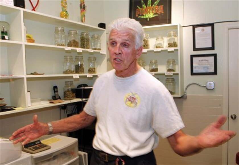 Don Boring talks about Colorado's new marijuana laws at his dispensary in Central City, Colo., on Monday, Aug. 30, 2010. Boring owns a grocery store, a liquor store and a medical marijuana dispensary all under one roof. The main difference between them is that for his pot business, he has to produce the inventory himself. (AP Photo/Ed Andrieski)