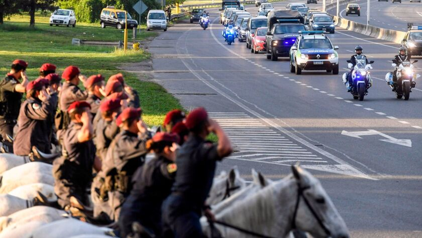 A convoy carrying the bodies of five Argentine victims of the truck attack in New York heads on Nov. 6 to Rosario, the city outside Buenos Aires where the men lived.