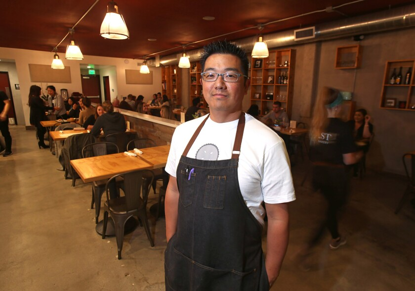Chef John Park stands in the new Toast Kitchen+Bakery dining room in Costa Mesa.