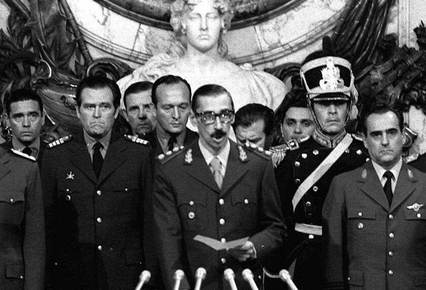FILE - In this March 24, 1976 file photo, Argentina's dictator Gen. Jorge Rafael Videla, center, is sworn-in as president at the Government House in Buenos Aires, Argentina. With a world divided by the Cold War, South America's dictatorships in 1975 agreed to start exchanging information on politic