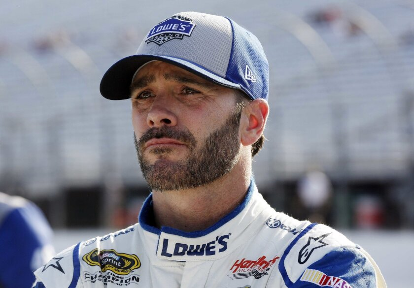 NASCAR driver Jimmie Johnson watches the clock runout during qualifying at New Hampshire Motor Speedway for Sunday's New Hampshire 301 auto race Friday, July 15, 2016, in Loudon, N.H. Johnson won the pole position for the race. (AP Photo/Jim Cole)