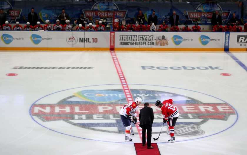 A ceremonial puck drop before the start of a game between the Florida Panthers and Chicago Blackhawks at Hartwall Arena in Helsinki, Finland, in 2009.