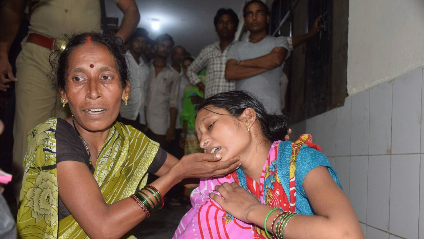 Relatives mourn the death of a child at Baba Raghav Das Hospital in Gorakhpur, India.
