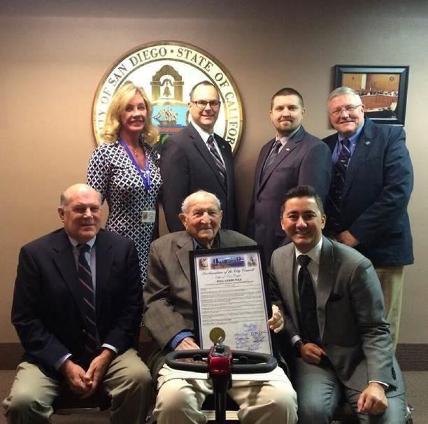 Top row: City of San Diego Real Estate Assets director (Airports Division) Cybele Thompson, airport program manager Wayne Reiter, airport operations assistant Paul Mehrlich, airport deputy director Rod Propst, with (Bottom row) Buzz Gibbs, Bill Gibbs and Councilmember Chris Cate at the Jan. 12 City
