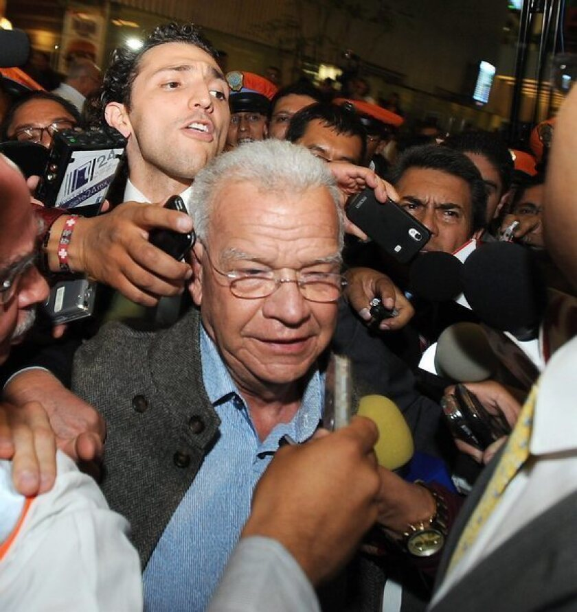 Former Tabasco Gov. Andres Granier talks to the media at his return at the airport in Mexico City on Tuesday.