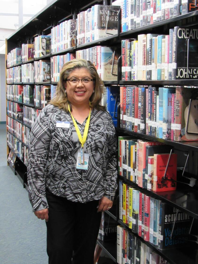 Branch Manager Christine Gonzalez is pictured in 2018 at the Point Loma/Hervey Library.
