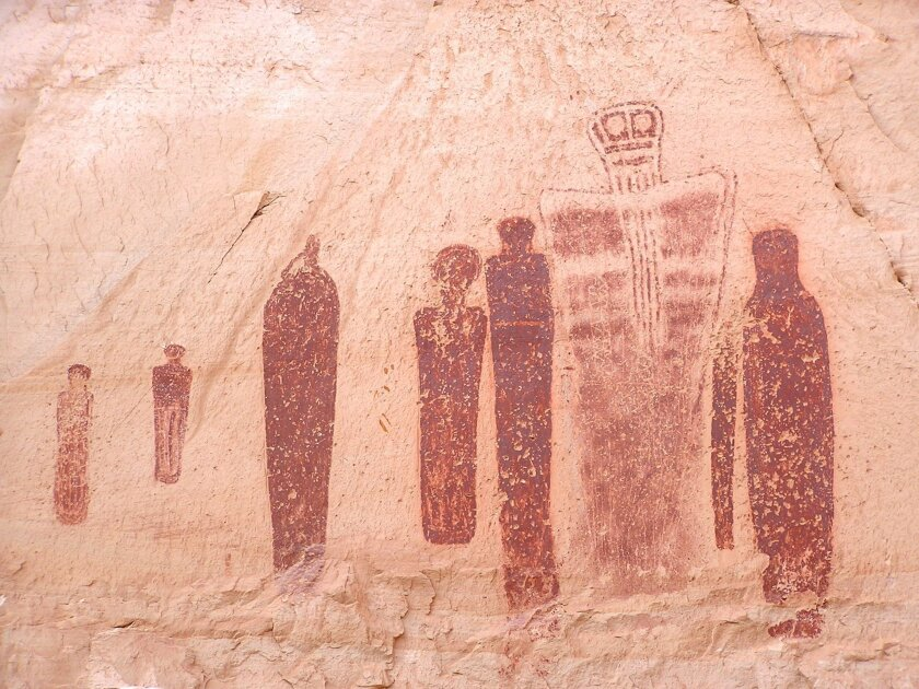 This undated photo provided by Utah State University shows the Holy Ghost group of the Great Gallery, a striking Barrier Canyon-style rock painting in Horseshoe Canyon of southern Utah's Canyonlands National Park. World-renowned rock art of life-sized figures sketched into red rock cliffs in Canyonlands National Park in Utah were actually drawn 1,000 years earlier than what had long been believed, a team of USU has found. (AP Photo/Utah State University, Joel Pederson)