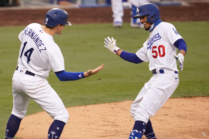 Enrique Hernandez #14 of the Los Angeles Dodgers congratulates Mookie Betts