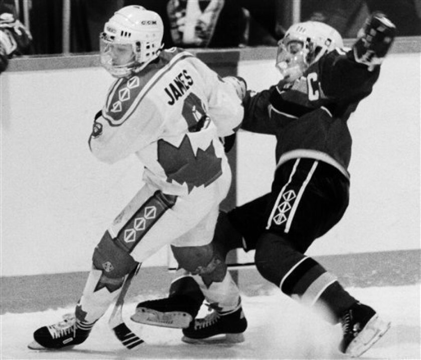 FILE - In this March 21, 1990 file photo, Team Canada's Angela James, left, checks Germany's Elvira Saager during the Women's World Hockey Championships in Ottawa. James was elected to the Hockey Hall of Fame on Tuesday, June 22, 2010. (AP Photo/The Canadian Press, Frank Gunn)