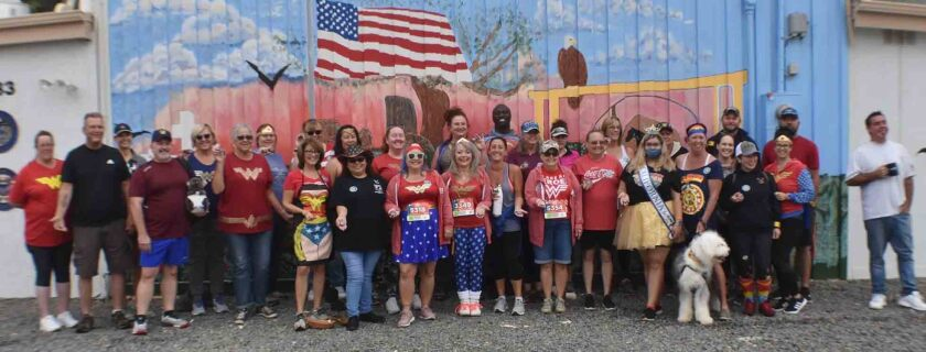 """Wonder Woman 5K fun run/walk participants were joined by VFW State Commander Dawn """"Dusty"""" Napier, shown sixth from the left."""