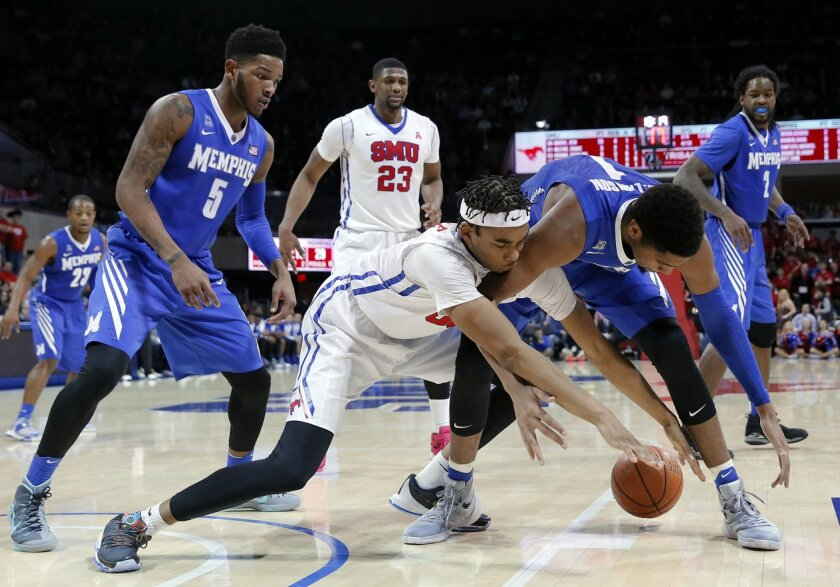 SMU forward Ben Moore, center, and Memphis forward Dedric Lawson (1) scramble for a loose ball during the second half of an NCAA college basketball game Saturday, Jan. 30, 2016, in Dallas. Memphis' Markel Crawford (5) and Shaq Goodwin (2) and SMU's Jordan Tolbert (23) watch in the 80-68 SMU win. (AP Photo/Tony Gutierrez)
