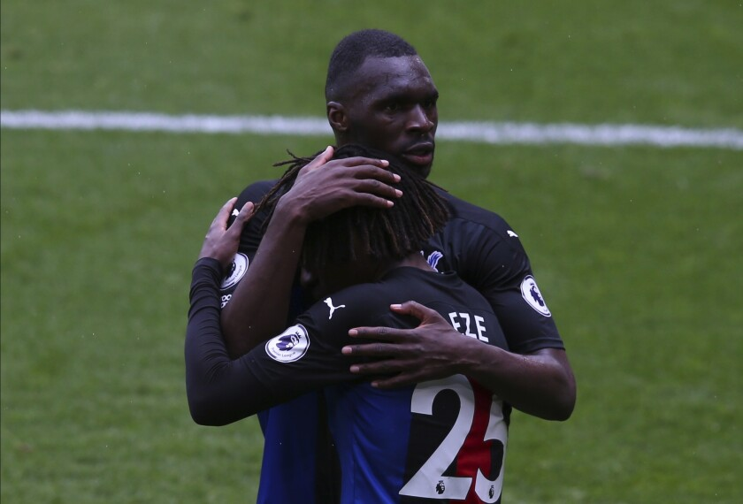 Crystal Palace's Eberechi Eze celebrates after scoring his side's second goal with Christian Benteke during the English Premier League soccer match between Sheffield United and Crystal Palace at Bramall Lane in Sheffield, England, Saturday, May 8, 2021. (AP Photo/Alex Livesey, Pool)