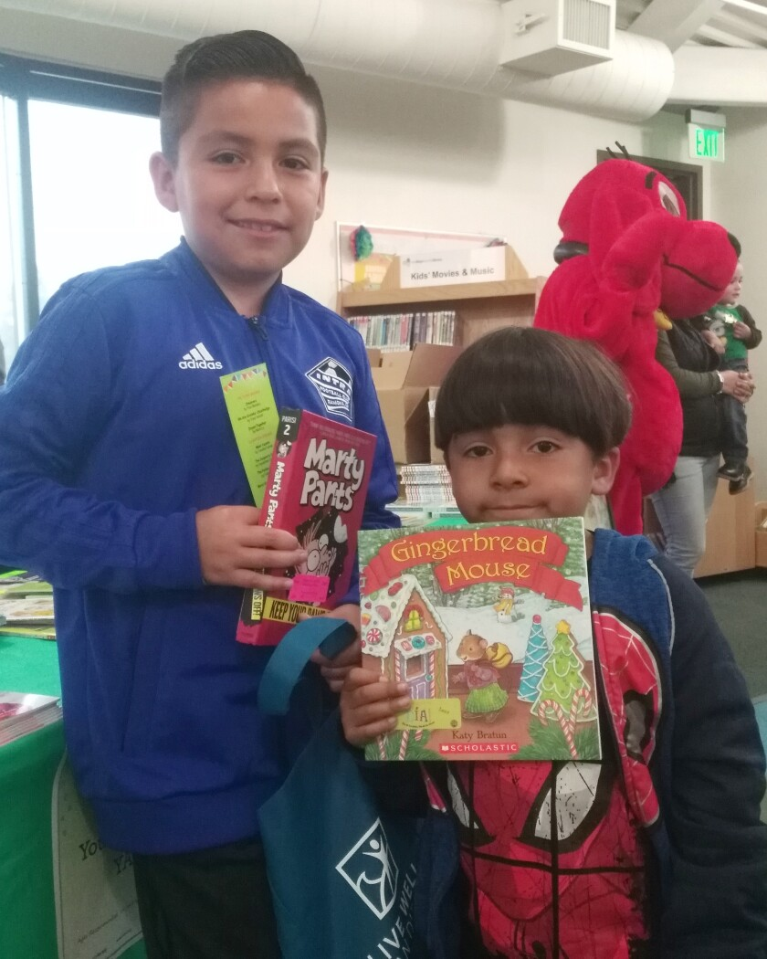 Copy - Jose and Julian Aguilar with Free Books.jpg