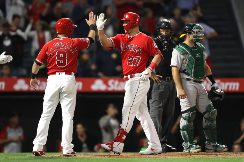 Mike Trout is congratulated by Angels teammate Tommy La Stella after hitting a home run on June 6, 2019.