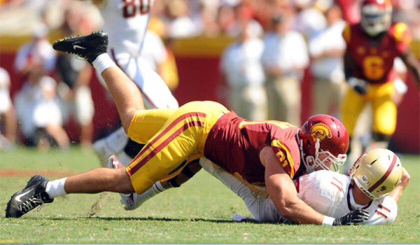 USC's Morgan Breslin takes down Boston College quarterback Chase Rettig during a 2013 game.