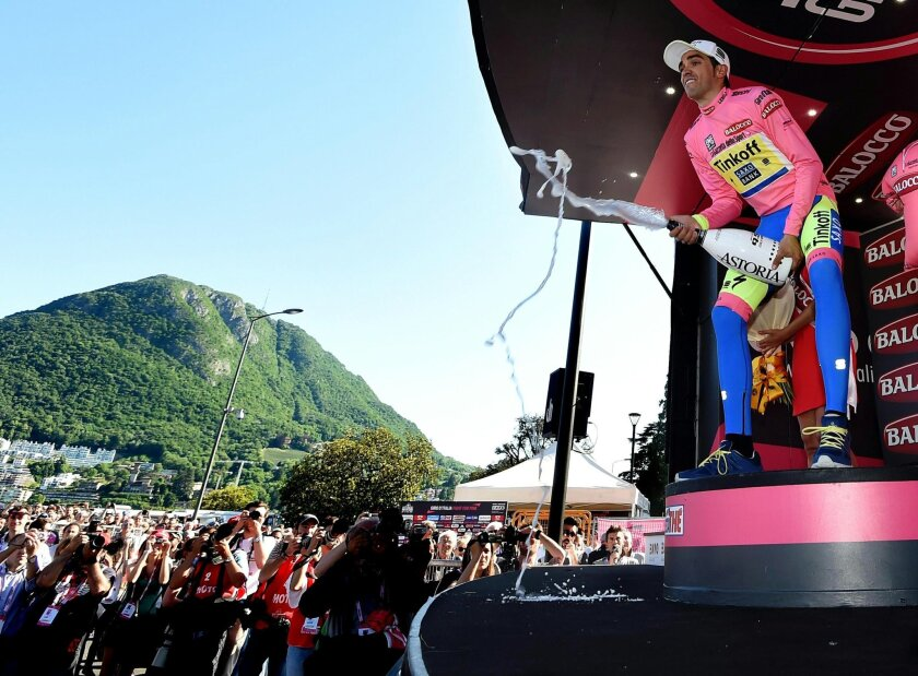 Spain's Alberto Contador celebrates at the end of the 17th stage of the Giro d'Italia, Tour of Italy cycling race from Tirano to Lugano, Switzerland, Wednesday, May 27, 2015. Alberto Contador maintained his grip on the overall lead of the Giro d'Italia, while Sacha Modolo won a bunch sprint at the end of the 17th stage for his second victory in this year's race. (Daniel Dal Zennaro/ANSA via AP)