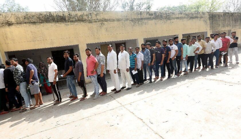 People line up to vote at a polling station in Dadri, in the northern state of Uttar Pradesh, as India begins multi-stage general elections on April 11.