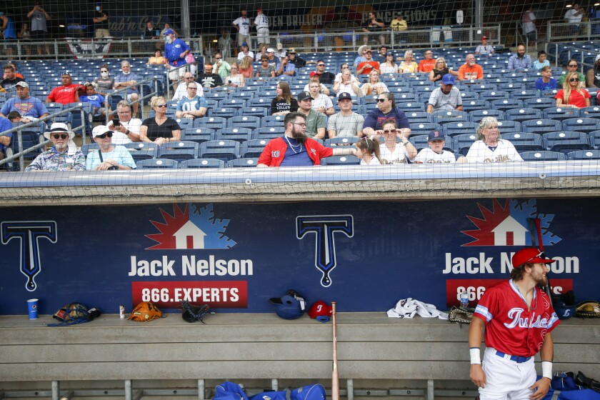 FILE - Tulsa Drillers' Hueston Morrill waits for his name to be announced at the Double-A baseball team's game against the Frisco RoughRiders in Tulsa, Okla., in this Tuesday, June 30, 2020, file photo. Minor league teams across the country are set to open their seasons Tuesday, May 4, 2021, returning baseball to communities denied the old national pastime during the coronavirus pandemic. (Ian Maule/Tulsa World via AP, File)