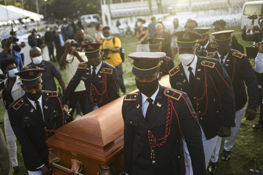 Police officers carry the coffin of slain Haitian President Jovenel Moise