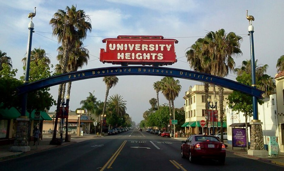 Community signs come in all shapes and sizes but the sky-high neighborhood archways are impossible to miss. Above, The University Heights sign pays homage to the trolley that once ran through to the Old Trolley Barn Park. And note the ostriches atop each pillar. Why are they there? Read on.