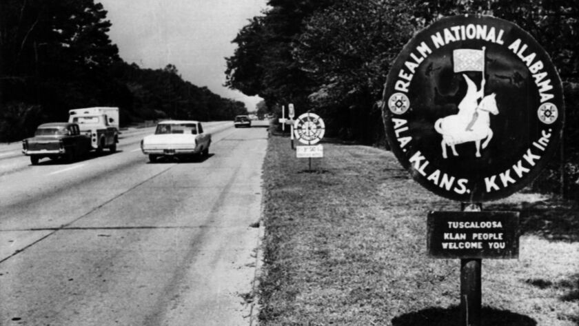 "In a 1963 photo, a Tuscaloosa, Ala., sign features the Ku Klux Klan. Decades later, a newspaper editor in a town about 70 miles south has suggested the KKK should return to ""clean out"" Washington."