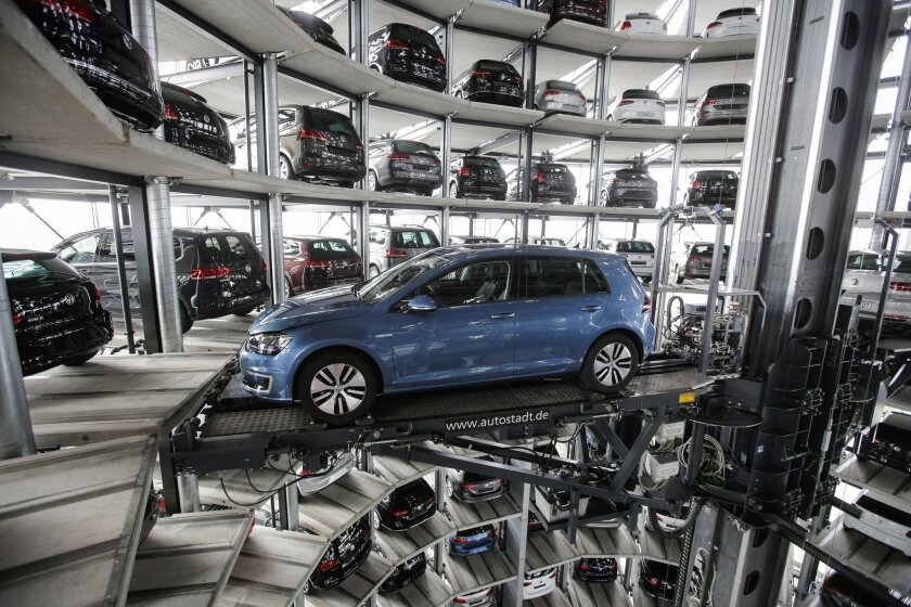 FILE - In this April 28, 2016 file photo a Golf Volkswagen car is presented to media inside a delivery tower prior to the company's annual press conference in Wolfsburg, Germany. Volkswagen will announce its first quarter earnings on May, 31, 2016. (AP Photo/Markus Schreiber, file)