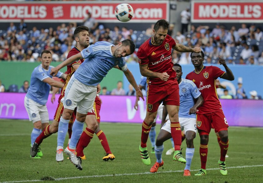 New York City FC forward David Villa, left, tries to score on a corner kick against Real Salt Lake forward Juan Martinez, right, during the first half of an MLS soccer game, Thursday, June 2, 2016, in New York. (AP Photo/Julie Jacobson)