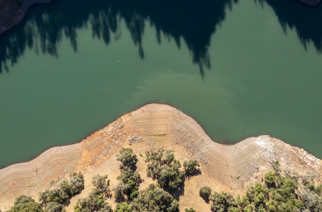 Land once underwater is exposed by receding water levels on Lake Sonoma in Geyserville, Calif.