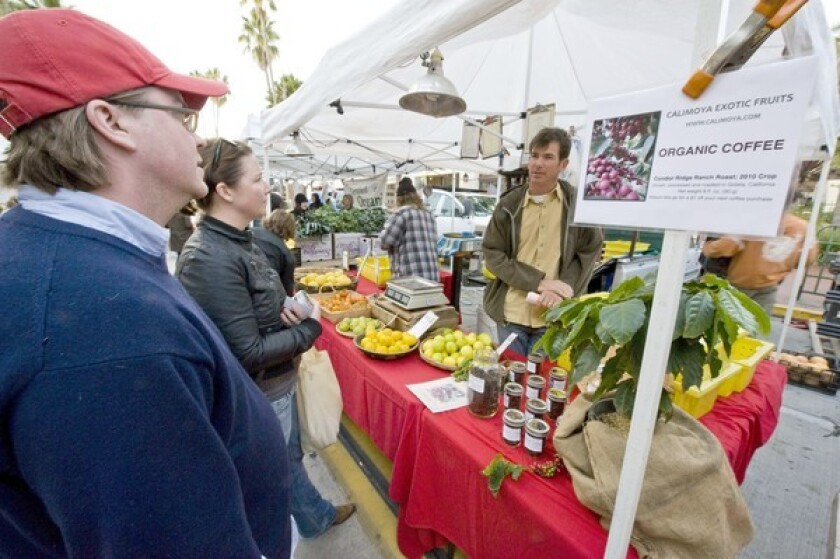 """John and Jennifer Wheir, coffee """"microroasters"""" based in Ventura, were amazed to see Jay Ruskey (right) selling coffee grown in Goleta at the Santa Barbara farmers market."""