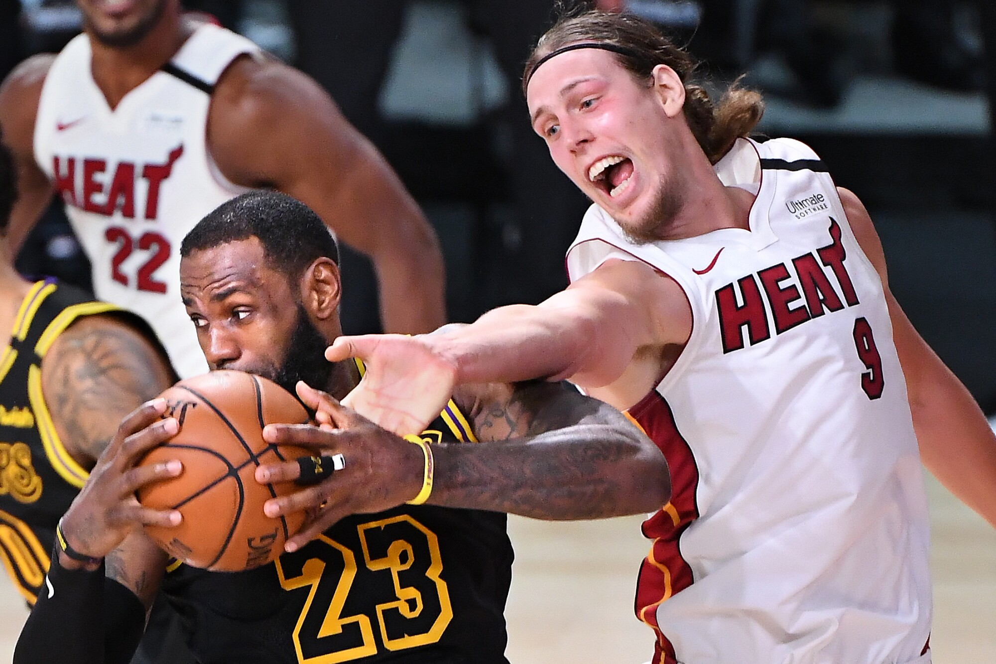 Lakers star LeBron James grabs a rebound in front of Miami's Kelly Olynyk during the second quarter of Game 2.
