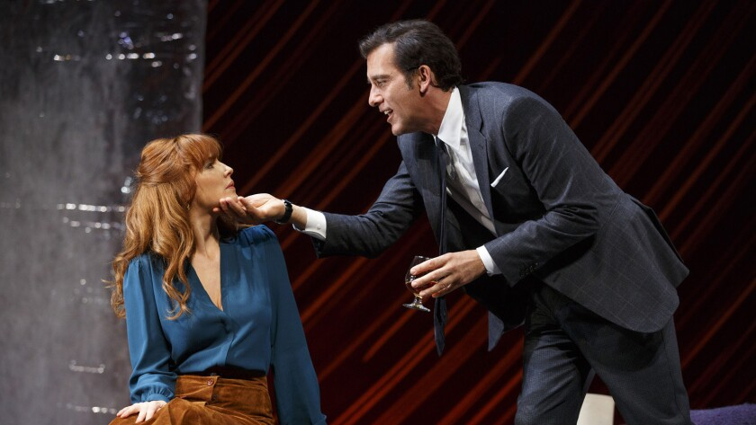 "Kelly Reilly, left, and Clive Owen appear during a performance of Harold Pinter's ""Old Times."" (Joan Marcus/Polk & Co. via AP)"