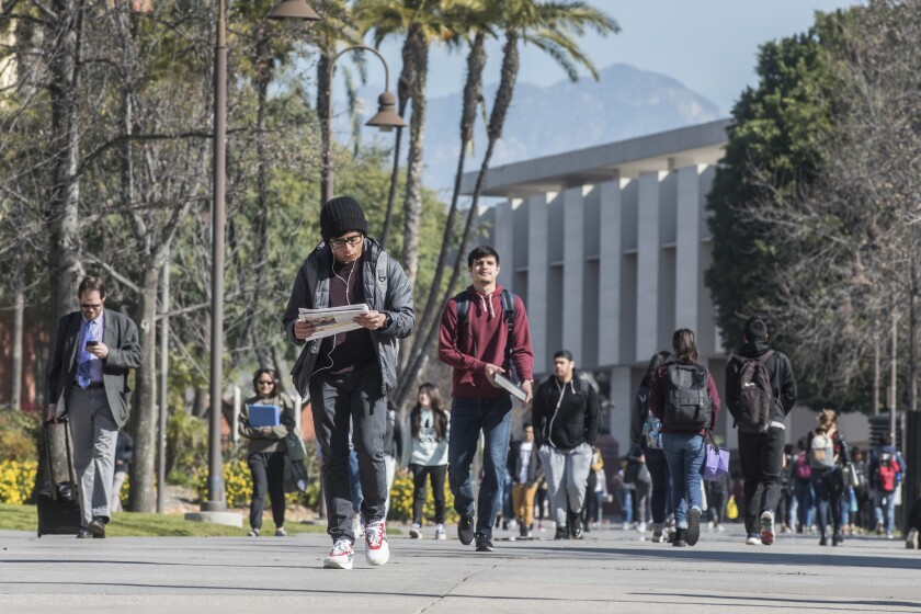 Students walk on the campus of Cal State Los Angeles on Monday morning, Feb. 25, 2018. The universit