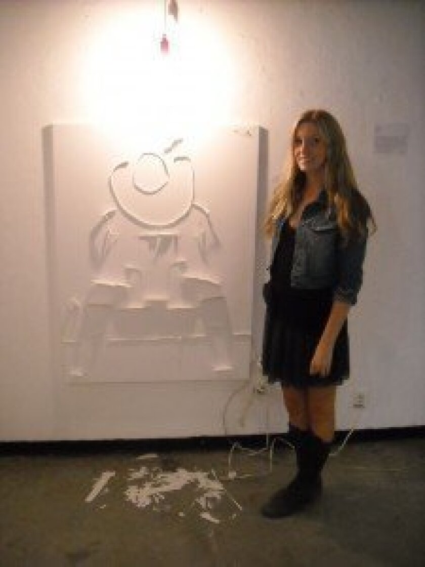 """Cassandra White with her art project composed of shadows, titled """"Displaced Persons"""" at ICAM presentations"""