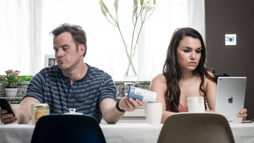 "Robert Kazinsky and Samantha Barks in the movie ""For Love or Money."""