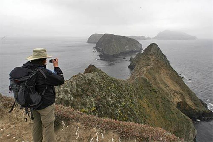 A hiker captures the view for posterity from Inspiration Point on East Anacapa Island.