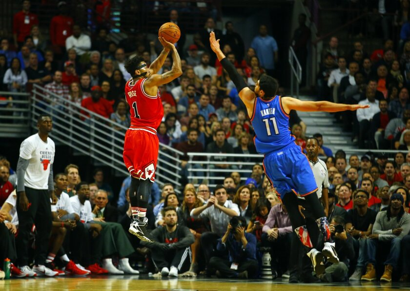 Chicago Bulls guard Derrick Rose (1) shoots over Oklahoma City Thunder center Enes Kanter (11) during the second half of an NBA basketball game in Chicago, on Thursday, Nov. 5, 2015. The Bulls won the game 104-98. (AP Photo/Jeff Haynes)