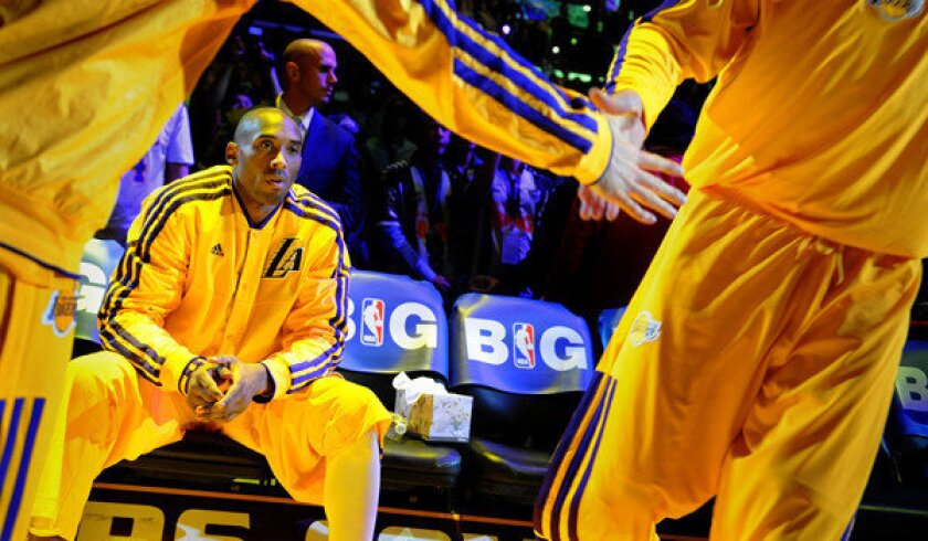 Kobe Bryant waits to be introduced before a game at the Staples Center.