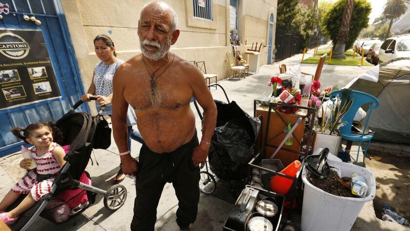 LOS ANGELES, CA – JUNE 21, 2018: Edgar Ruiz, 63, rests at his sidewalk encampment on Leeward Aven